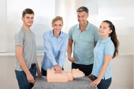 cardiopulmonary: Female Students Practicing Cardiopulmonary Resuscitation Cpr On Dummy Stock Photo