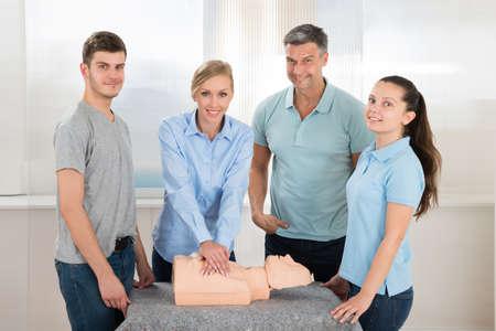 cardiopulmonary resuscitation: Female Students Practicing Cardiopulmonary Resuscitation Cpr On Dummy Stock Photo