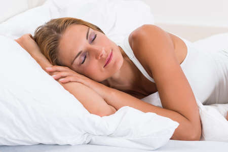 sleeping woman: Portrait Of Young Beautiful Woman Sleeping In Bed