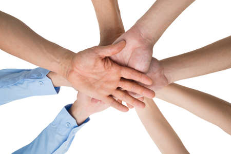 in low spirits: Low Angle View Of People Hands Stacking Together Over White Background Stock Photo