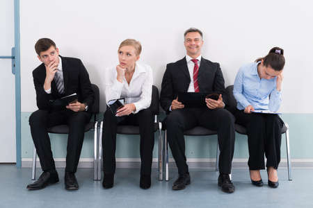 Businesspeople Sitting On Chair Waiting For Job Interview In Office 스톡 콘텐츠