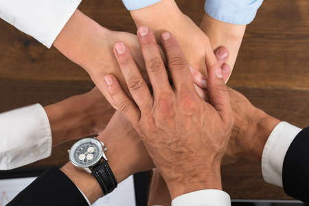 High Angle View Of Businesspeople Hands Stacking Over Each Other