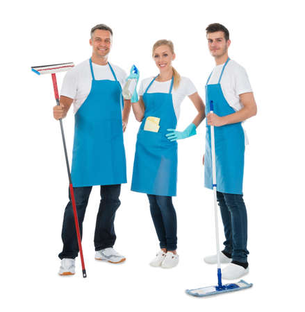 cleaning gloves: Group Of Cleaning Workers With Cleaning Equipments Over White Background Stock Photo
