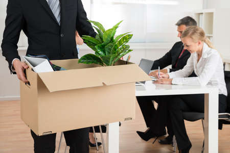 Close-up Of Businessman Carrying Personal Belongings In Office