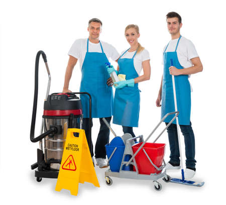 over white: Group Of Janitors With Cleaning Equipments Over White Background