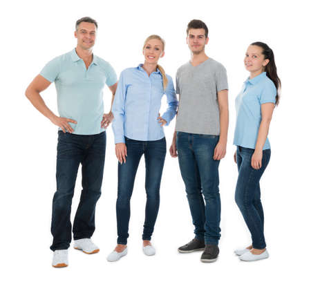 adult woman: Group Of Happy People In Casual Standing Over White Background Stock Photo