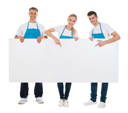cleaning team: Group Of Cleaners Holding Blank Billboard Over White Background