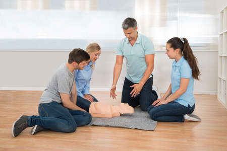reanimate: Male Instructor Showing Resuscitation Technique To His Students