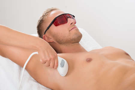 Beautician Giving Laser Epilation Treatment On Mans Armpit Stock Photo