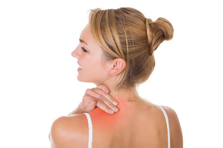 shoulder problem: Rear view of sad young woman suffering from shoulder pain over white background