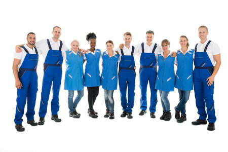 arms around: Full length portrait of confident multiethnic janitors standing with arms around against white background