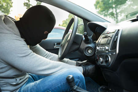 lawbreaker: Thief With Mask Trying To Steal A Car Stock Photo