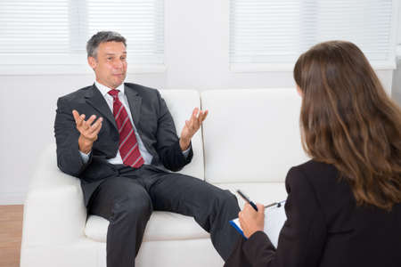 psychiatrist: Male Patient On Couch Talking With Professional Psychiatrist