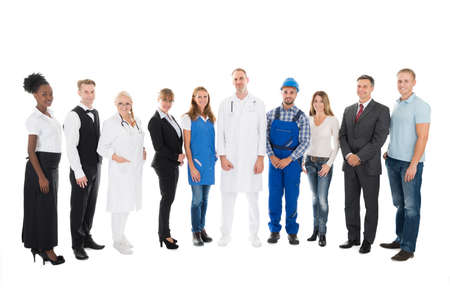 occupations: Full length portrait of people with various occupations standing in row against white background Stock Photo