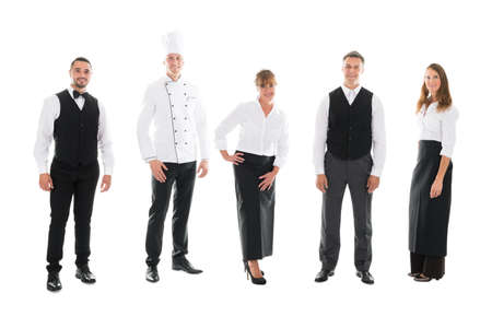 thirties portrait: Full length portrait of happy restaurant staff standing over white background Stock Photo