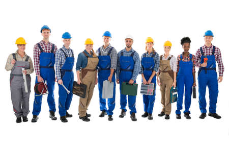 toolbox: Full length portrait of confident carpenters carrying toolboxes against white background Stock Photo