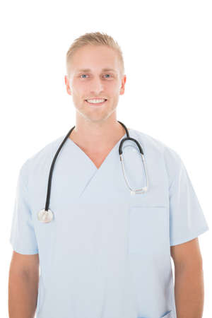 mid adult male: Portrait of happy mid adult male surgeon standing against white background