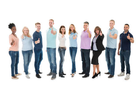 Full length portrait of creative business people standing together against white background Stock Photo