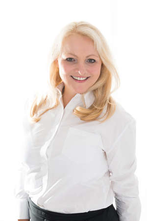 caterers: Portrait of mature hostess standing against white background