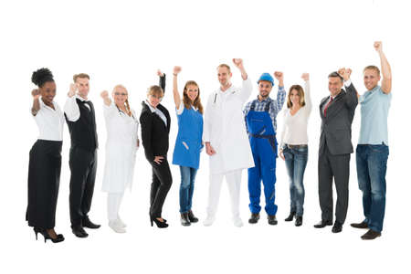 occupations: Full length portrait of people with various occupations cheering against white background