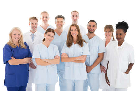 staff: Portrait of happy multiethnic medical team standing against white background