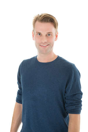 casuals: Portrait of smiling man in casuals standing against white background