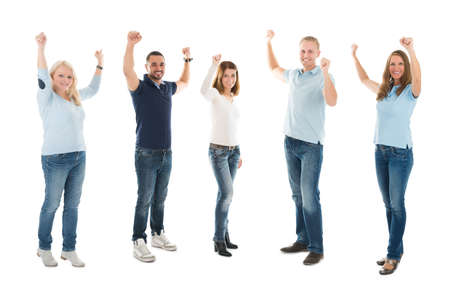 casuals: Full length portrait of people in casuals standing with arms raised isolated on white background Stock Photo