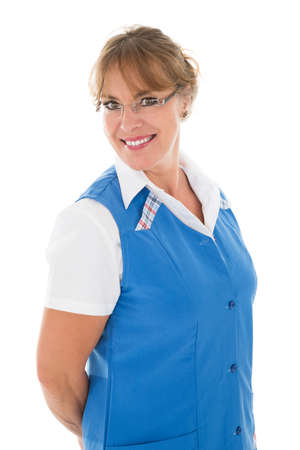 janitor: Portrait of happy mature female janitor standing against white background