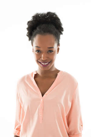 casuals: Portrait of smiling young woman in casuals standing against white background
