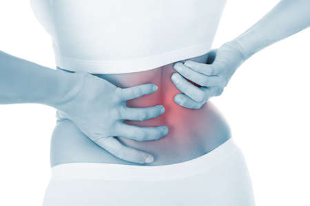 adult bones: Sad young woman suffering from back pain over white background