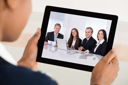 video conference: Close-up Of A Businesswoman Video Conferencing On Digital Tablet