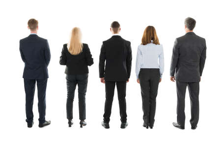 Full length rear view of business people standing against white background Banco de Imagens
