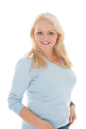 mid thirties: Portrait of happy mid adult woman in casuals standing against white background Stock Photo