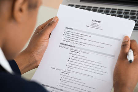 interviewing: Close-up Photo Of A Businesswoman Holding Resume