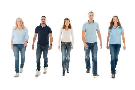 casuals: Full length portrait of confident people in casuals walking against white background