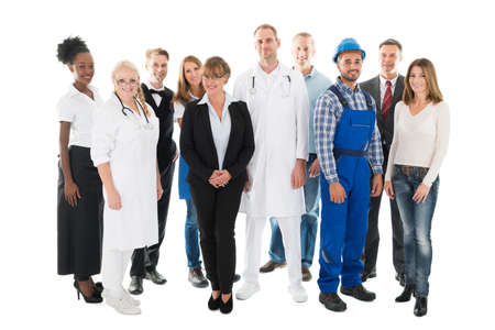 various occupations: Group portrait of confident people with various occupations standing against white background Stock Photo