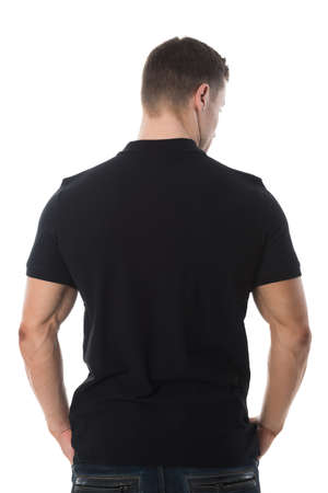 Rear view of man wearing blank black tshirt standing against white background