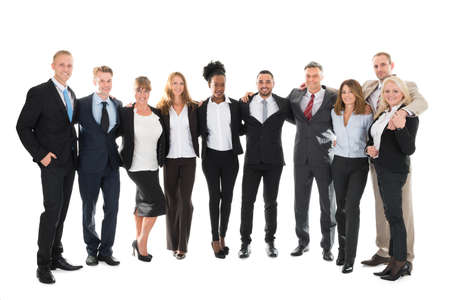 looking around: Full length portrait of confident business team standing with arms around against white background Stock Photo