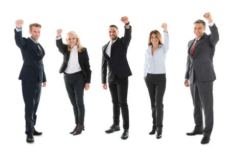 woman business suit: Full length portrait of cheerful business people celebrating success against white background