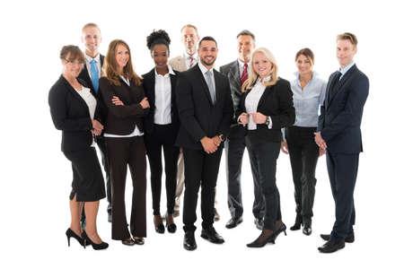 full length woman: Full length portrait of confident business team standing against white background