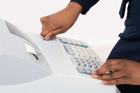 cash receipt: Close-up Of A Sales Person Operating Cash Register