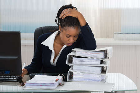 stress woman: Portrait Of A Upset African Businesswoman In Office