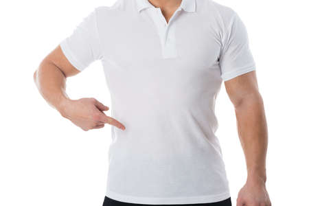 casuals: Midsection of man in casuals standing against white background