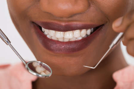oral care: Close-up Photo Of Woman Examining Her Teeth