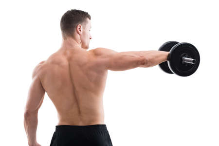 rear view: Rear view of strong man lifting dumbbell while standing against white background Stock Photo