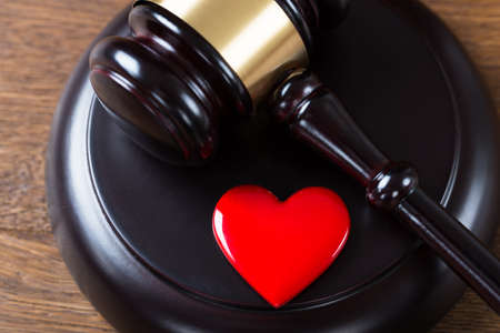 High angle view of mallet and heart on table in courtroom