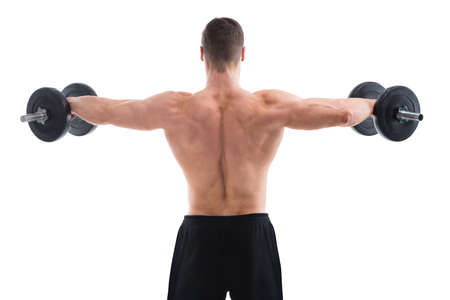 levantar peso: Rear view of muscular man lifting dumbbells against white background