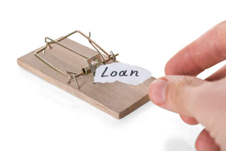cropped: Cropped hand reaching loan sign on mousetrap against white background