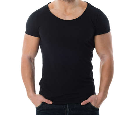 black male: Midsection of man wearing blank black tshirt standing with hands in pockets against white background Stock Photo
