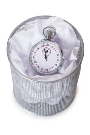 dustbin: Alarm clock on papers in dustbin against white background